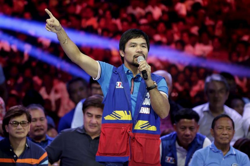 Filipino boxer Manny Pacquiao speaks to supporters during the start of elections campaigning in Mandaluyong city, Manila.