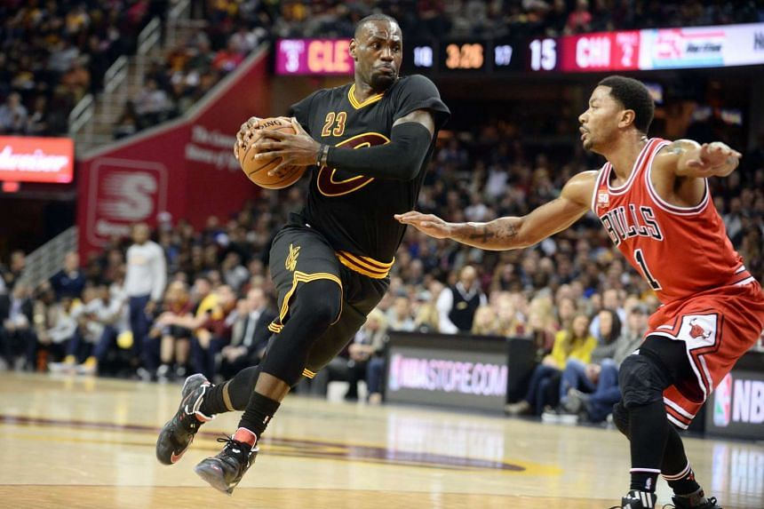 Cleveland Cavaliers forward LeBron James drives against Chicago Bulls guard Derrick Rose.