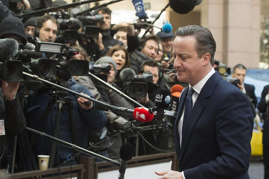 British Prime Minister David Cameron speaks to the media at the EU summit in Brussels on Feb 19, 2016.