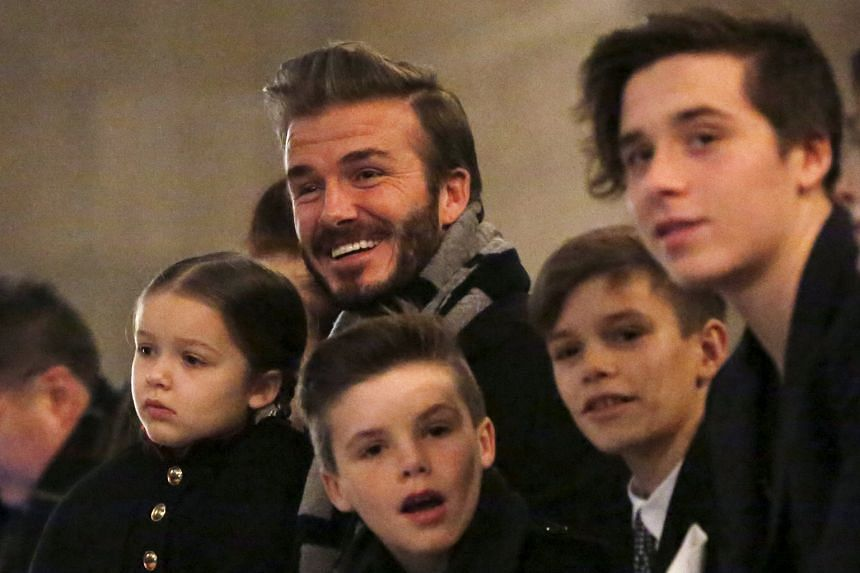 David Beckham in the front row at the Victoria Beckham Fall/Winter 2016 collection presentation with his children (from left) Harper, Cruz, Romeo and Brooklyn at New York Fashion Week.