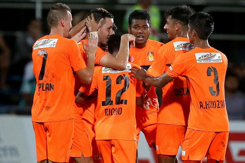 Hougang United's Croatian midfielder Stipe Plazibat (second from left) is the toast of his team-mates, after opening their account in the 34th minute of their S-League opener against Home United last night. It was the only goal of the game as the Che
