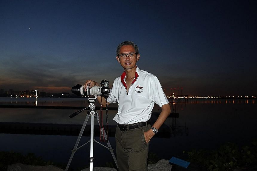 Mr Soh venturing to Pandan Reservoir in Jurong to try and snap photos of the five planets - Mercury, Venus, Saturn, Mars and Jupiter. The bright speck in the sky is Venus.