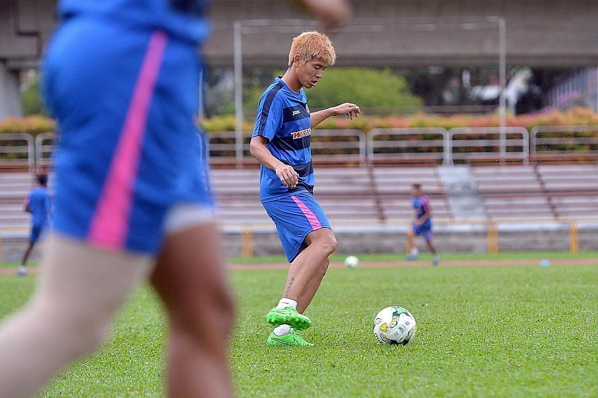 Kento Fukuda training at Woodlands Stadium last week. Though Madhu Mohana is suspended, Fukuda expects the Warriors defence to keep Stags star Jermaine Pennant under control.