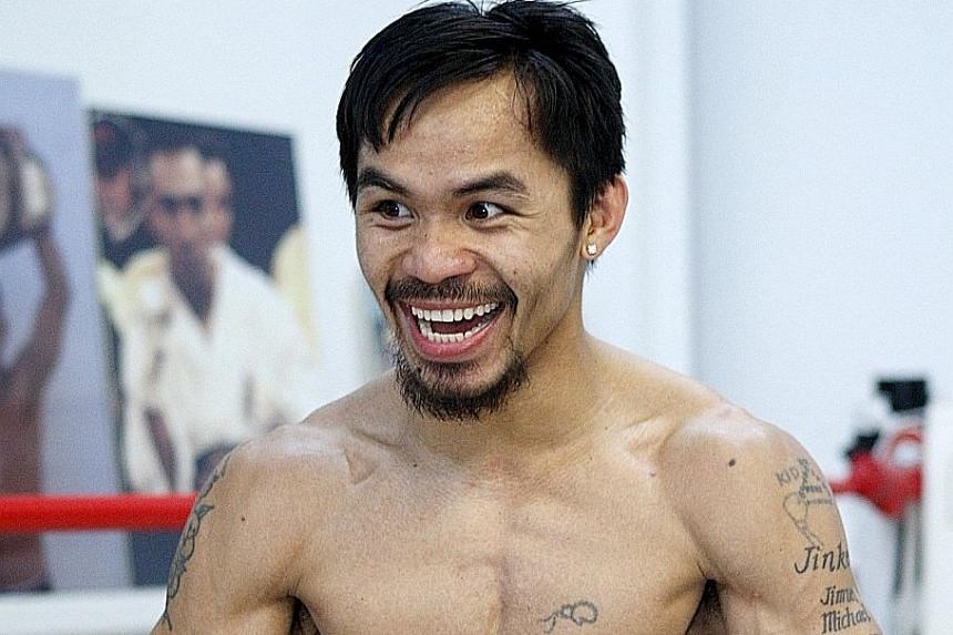"""Manny Pacquiao working out in 2009. Nike ended its contract with him after the Filipino boxer described gays as """"worse than animals""""."""