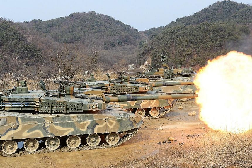 South Korean army tanks during a live firing drill yesterday. The United States and South Korea will be holding two joint military exercises next month.