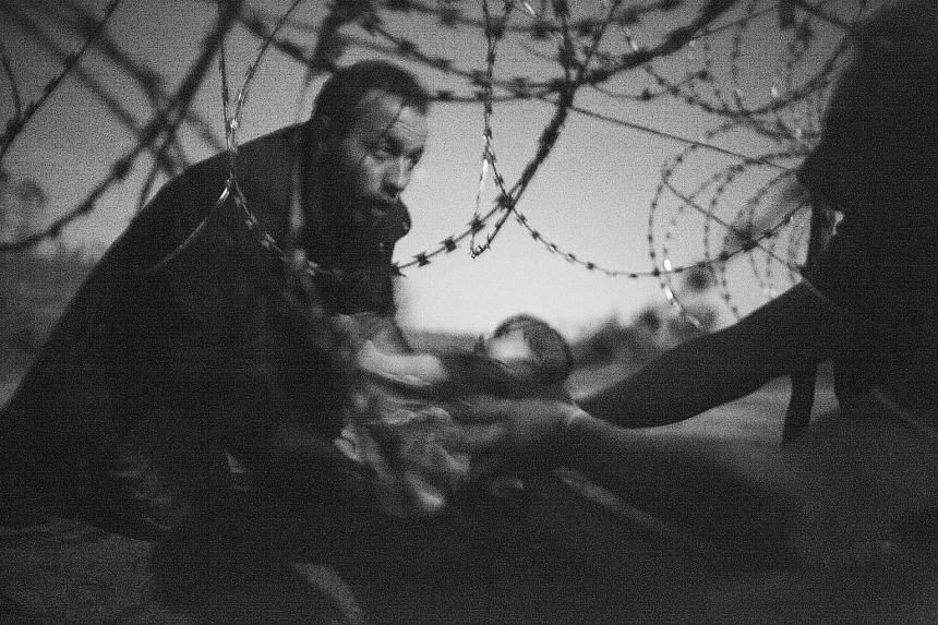 """The image, titled """"Hope for a new life"""", highlights Europe's worst migrant crisis since World War II."""