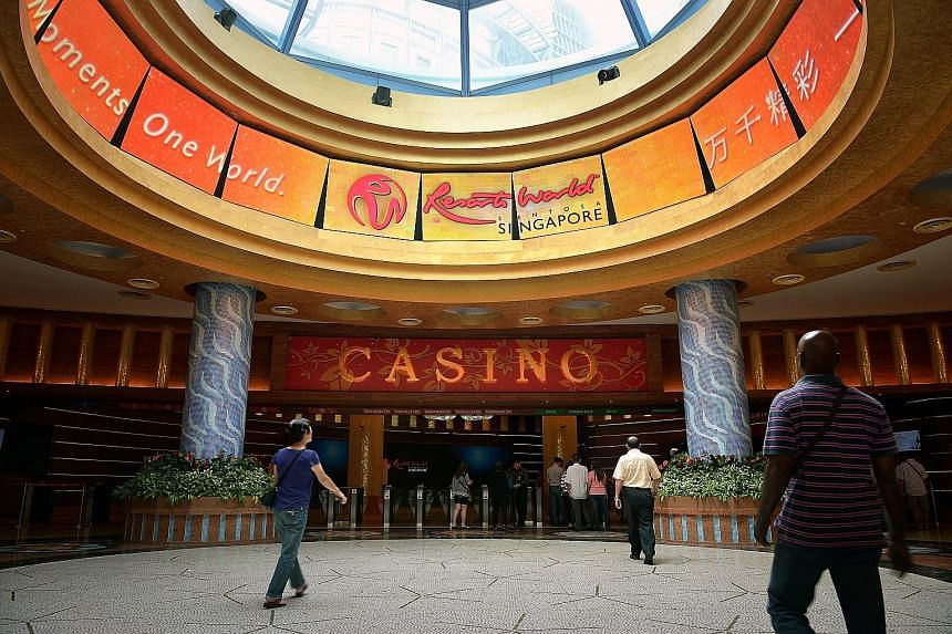 Genting Singapore, which operates the Resorts World Sentosa integrated resort (left), saw gaming revenue fall 19 per cent to $374 million as a result of lower gaming volume as the group continues to tighten its credit policy.