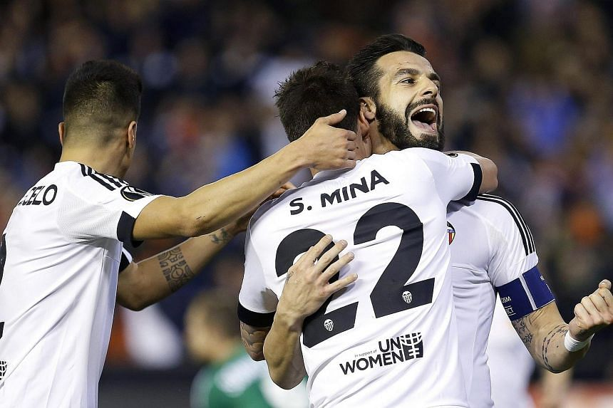 Valencia striker Alvaro Negredo (right) celebrates after scoring their fourth goal against Rapid Vienna.