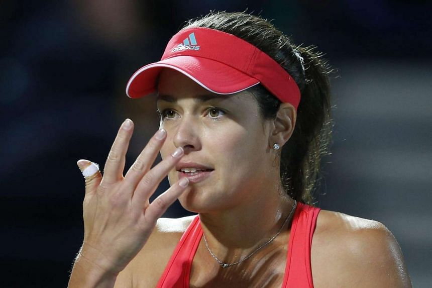 Ana Ivanovic reacts during her quarter-final loss to Barbora Strycova.