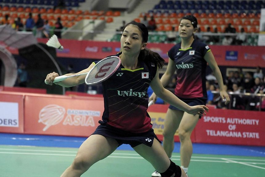 Misaki Matsutomo (left) and Ayaka Takahashi of Japan in action at the Badminton Asia Team Championships in Hyderabad, on Feb 18, 2016.