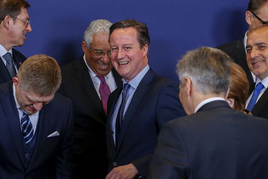 British Prime Minister David Cameron (centre) and other EU leaders take part in a group photo at a European Union leaders summit on Feb 18, 2016.