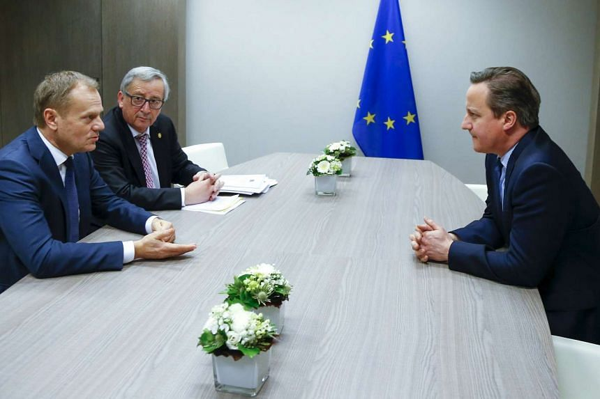 European Council President Donald Tusk (left) and European Commission President Jean Claude Juncker (centre) speaks with British Prime Minister David Cameron at the European Union leaders summit.