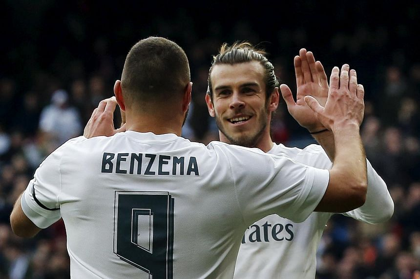 Real Madrid's Karim Benzema celebrates a goal with team mate Gareth Bale (right).