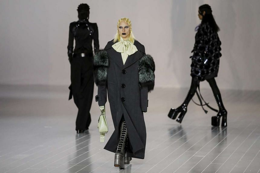 Singer Lady Gaga presents a creation by Marc Jacobs during his Fall/Winter 2016 collection.