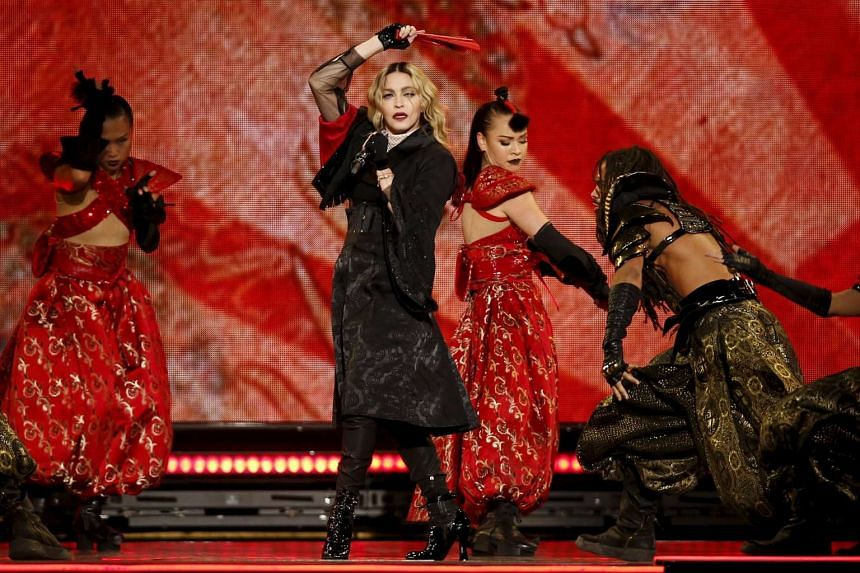 Madonna performing at the AccorHotels Arena in Paris on Dec 9, 2015.