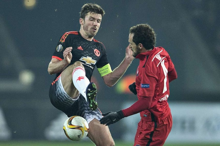 Manchester United captain Michael Carrick and Midtjylland's Marco Urena in action.