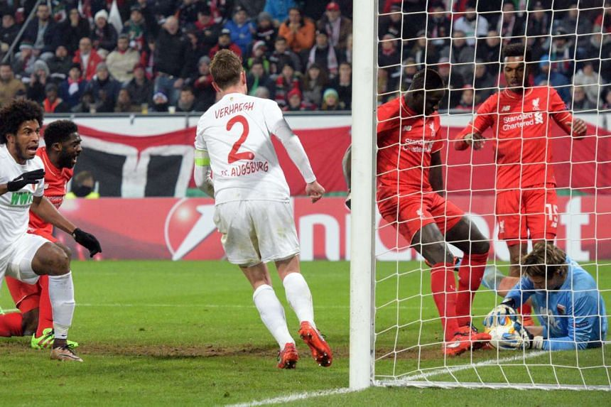 A penalty box scramble during the Europa League match between Augsburg and Liverpool.