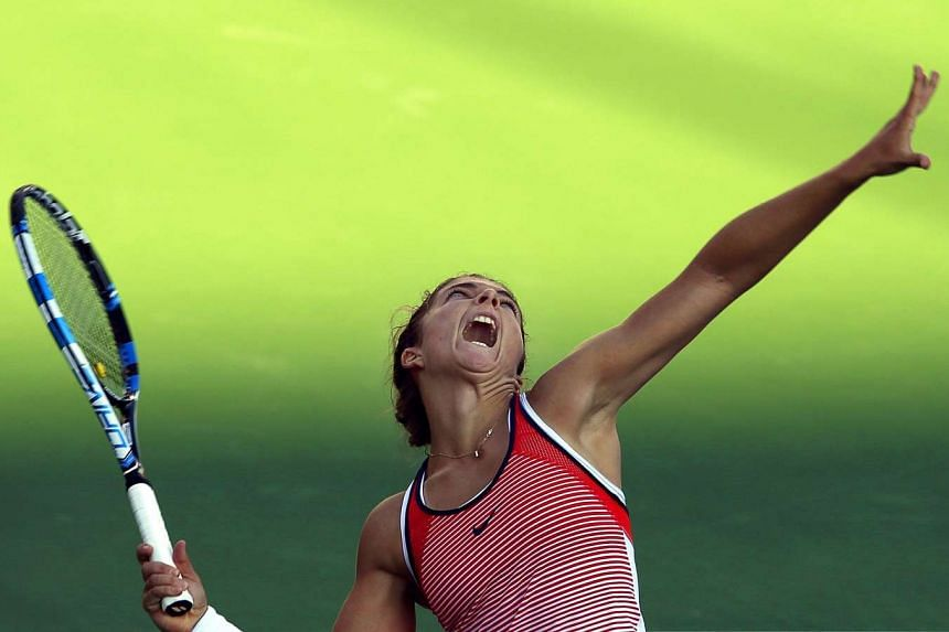 Sara Errani of Italy serves to Madison Brengle of the USA during their quarter final match.