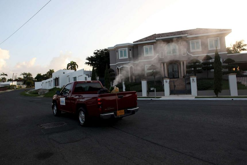 A pickup truck from the Department of Health carrying out fumigation in a San Juan neighbourhood.