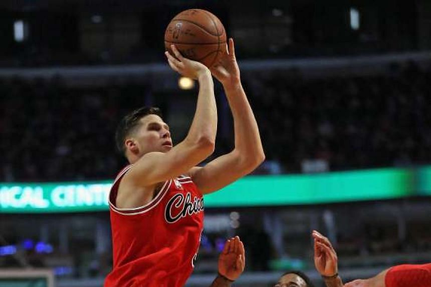 Doug McDermott puts up a shot during the match against the Toronto Raptors on February 19, 2016.