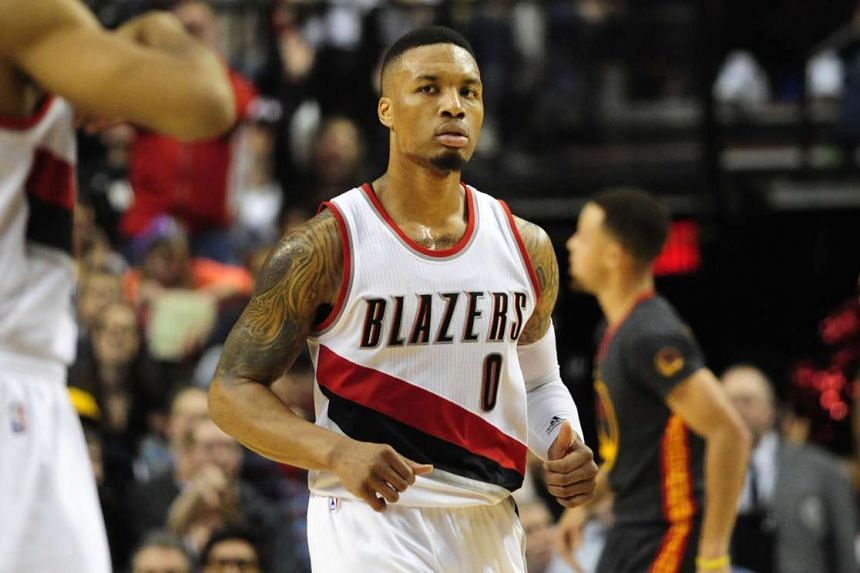 Damian Lillard reacts after hitting a three point shot during the game against the Golden State Warriors on Feb 20, 2016.
