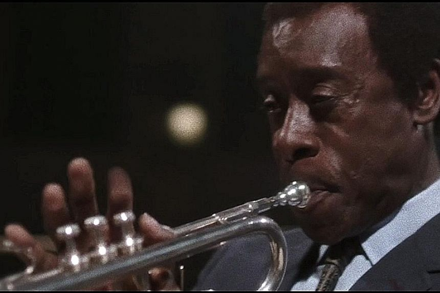 Don Cheadle learnt to play the trumpet for his role as jazz legend Miles Davis.