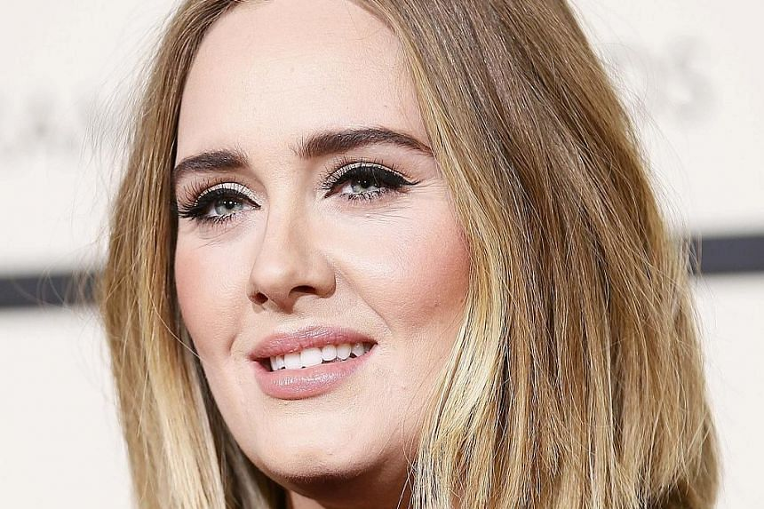 Singer Adele says she cried all day after she sang All I Ask off-key on the Grammys stage.