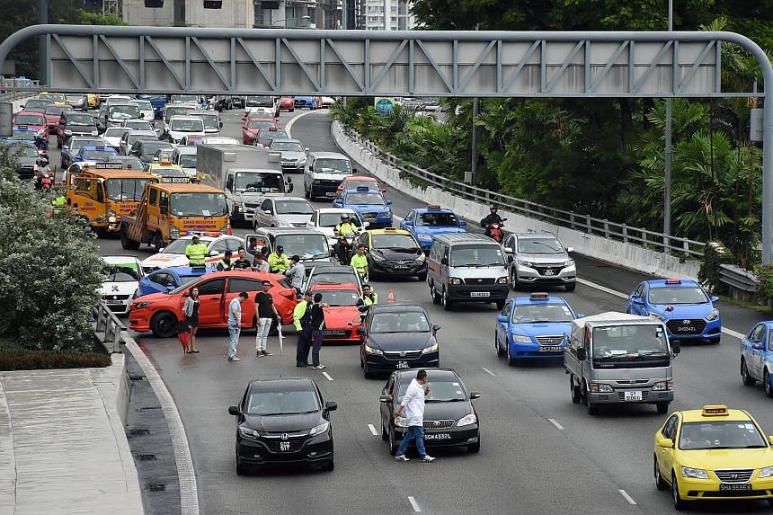 Six cars, a taxi, a lorry and a motorcycle were involved in a pile-up on the CTE towards the AYE, near the Cairnhill exit, yesterday morning. It was one of at least 20 expressway accidents before 11am yesterday.
