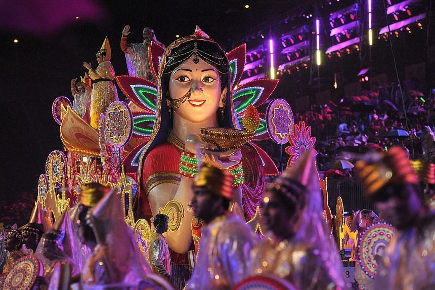 Stiltwalkers from Tian Loong Kong Stilt Walking Group and Johor Bahru Hong Yang Sports Association strutting their stuff at the Chingay parade last night. The procession featured participants from various ethnic backgrounds and moved along the route