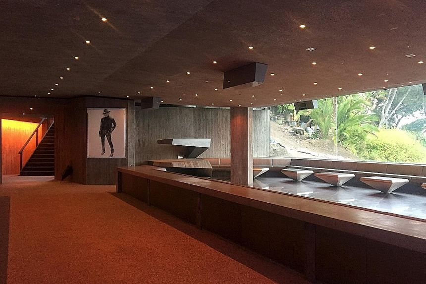 Built by American architect John Lautner, the house has expansive living areas (left) and offers panoramic views (above) as well as spots for lounging (right).