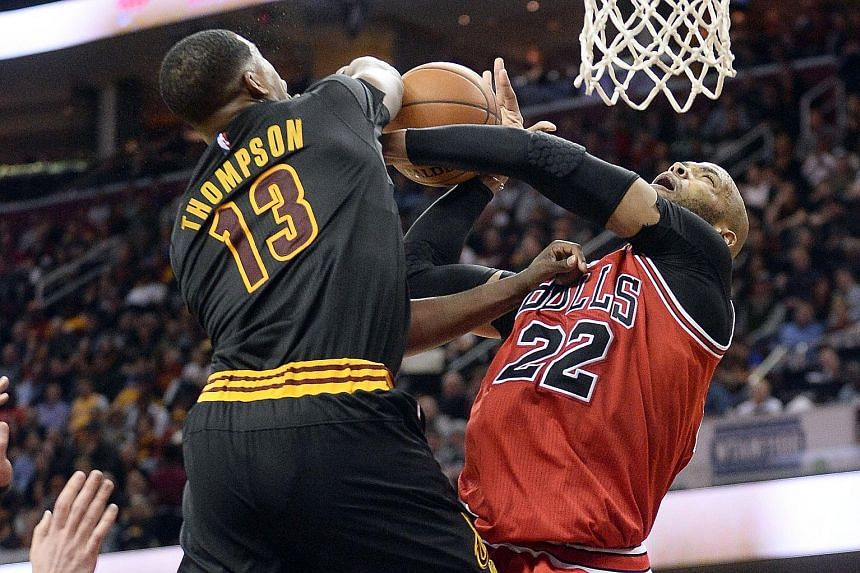 Cleveland Cavaliers centre Tristan Thompson blocking the shot of Chicago Bulls forward Taj Gibson during the third quarter at the Quicken Loans Arena. The Cavs, chasing that elusive NBA crown, won 106-95 to extend their lead atop the Eastern Conferen