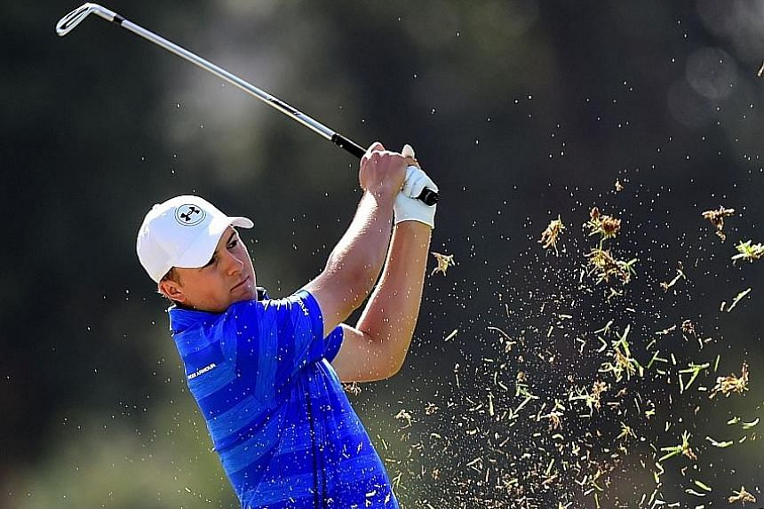 The world's No. 1 golfer Jordan Spieth hits out of the rough on the ninth hole during round one of the Northern Trust Open at Riviera Country Club in Pacific Palisades, California. The American fired the worst first round of his career - an eight-ove