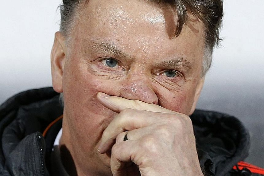 Louis van Gaal's (above) chances of staying on as Manchester United manager suffered a further blow, after Midtjylland's Paul Onuachu (right) scored the winner in their 2-1 win over the Red Devils in the first leg of their Europa League round-of-32 t