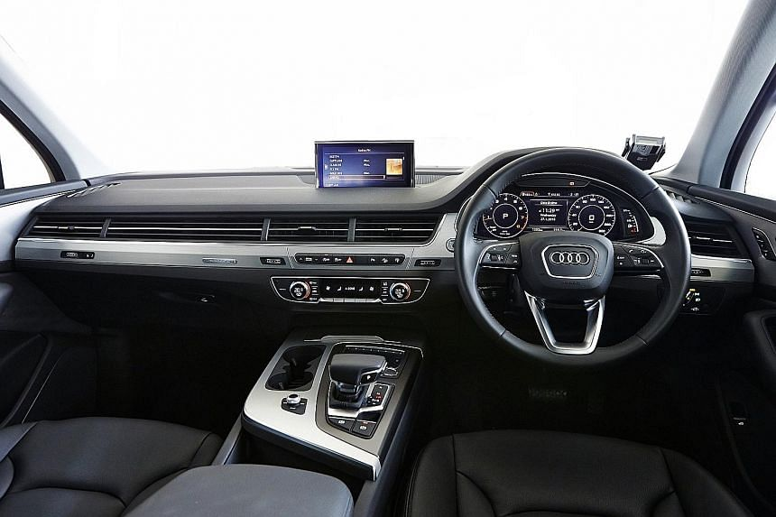 The knurled finish on the control knobs in the Audi (above) is a luxurious touch and the Volvo boasts a massive touchscreen (below).