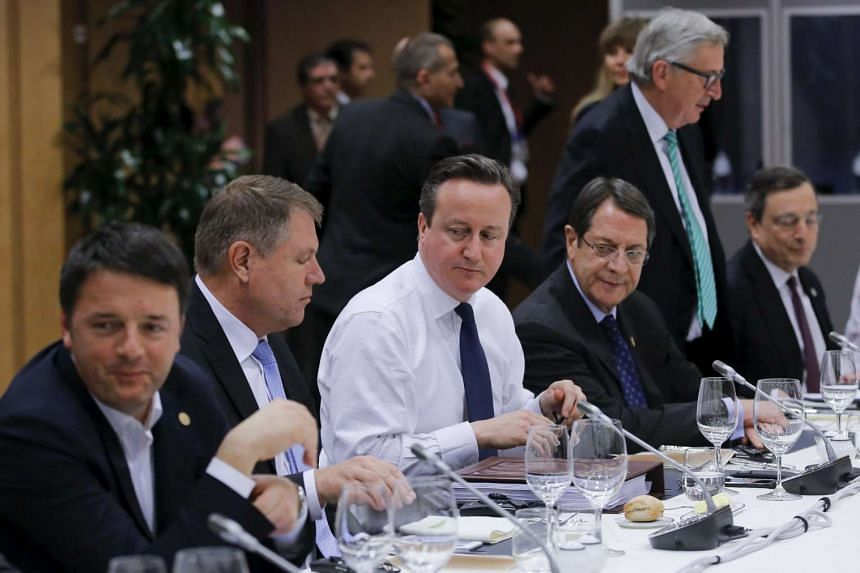 British Prime Minister David Cameron (centre) attends a meeting with European Union leaders during the EU summit.