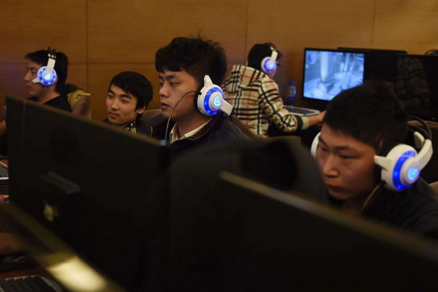 Men looking at computers in an internet bar in Beijing on Dec 16, 2015.