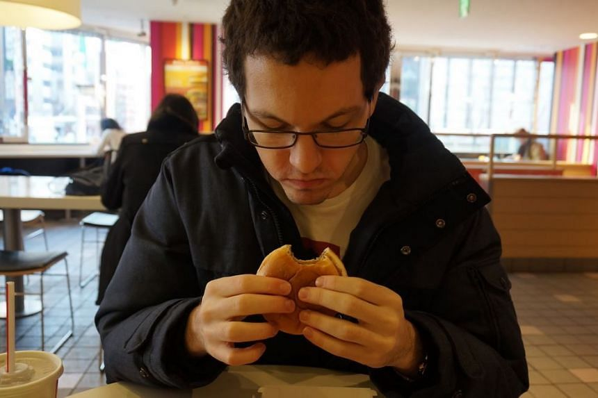 Mr James McGowan trying out the Hokkaido burger in Sapporo, Japan.