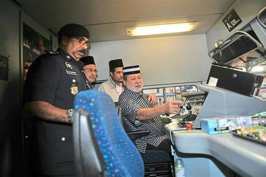 Sultan Ibrahim checking out the equipment before driving KTMB's Blue Tiger diesel electric train for over 200km from Kuala Lumpur to Segamat.