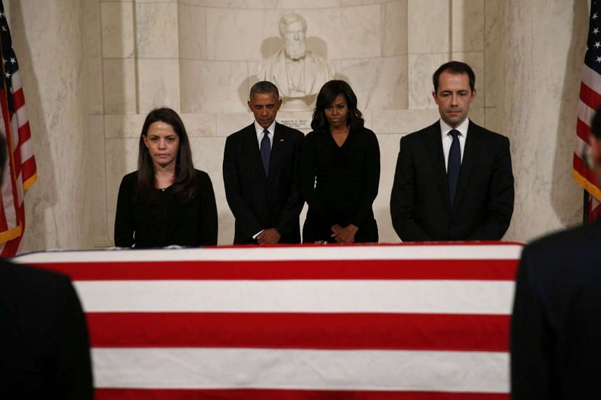 Obama (centre left) and first lady Michelle Obama (centre right) visit the casket of late U. Supreme Court Justice Antonin Scalia.