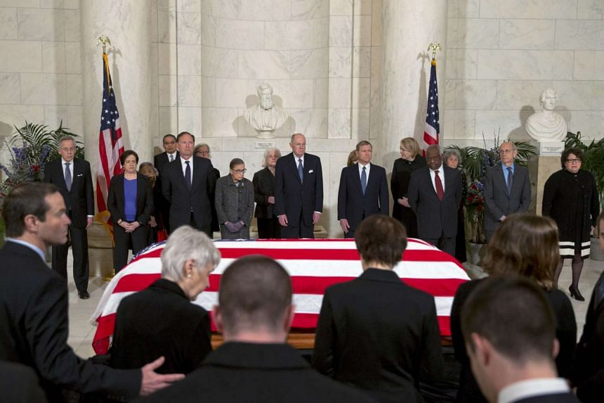 Family members of late US Supreme Court Justice Antonin Scalia take their seats for the ceremony.