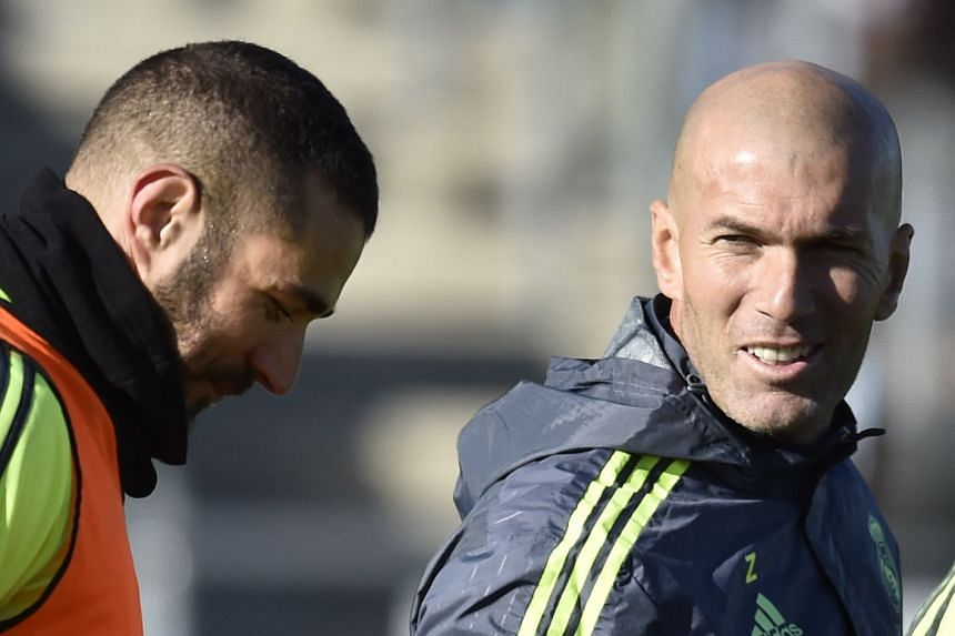 Zidane (right) with Benzema during his first training session as coach of Real Madrid on Jan 5, 2016.
