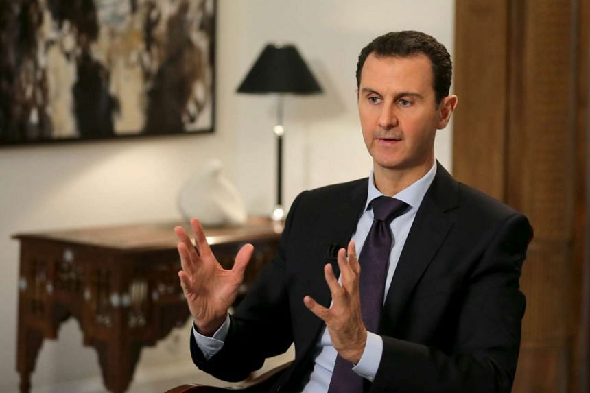 Syrian President Bashar Assad giving an interview to the AFP news agency, in Damascus, Syria.