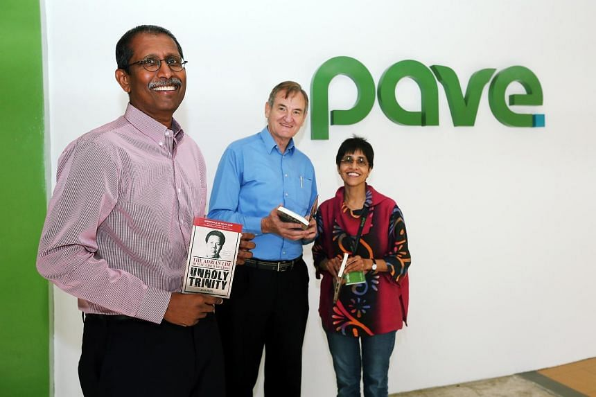 Vice-president of Pave Alan John, president Michael Gray and executive director Sudha Nair, with copies of the newly launched reprint of Mr John's book, Unholy Trinity. Mr John is donating royalties from the book's sales to the charity.
