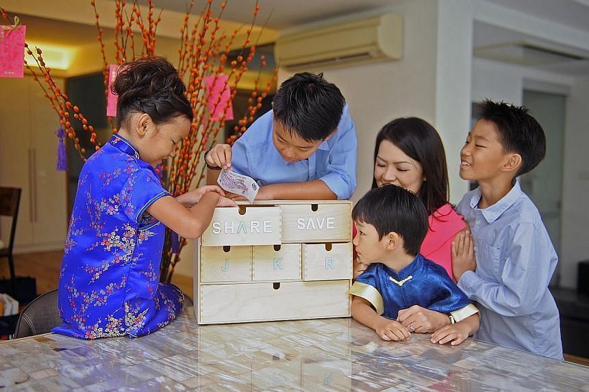 Ms Ang ensures that her children - (from left) Kate, Ryan, Zachary and Joshua - understand the value of saving from a young age.