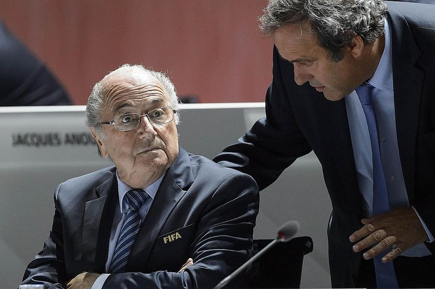 Sepp Blatter (left) claims that Michel Platini was pressured by then French president Nicolas Sarkozy to vote for Qatar, which the Frenchman has always denied.
