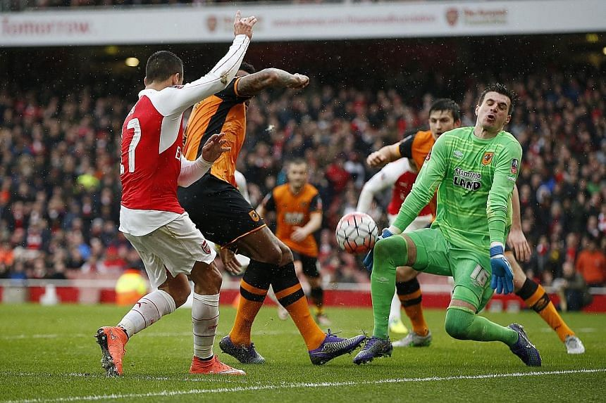 Hull custodian Eldin Jakupovic making one of his many saves, this time from Arsenal's Alexis Sanchez, during their FA Cup fifth-round clash at the Emirates Stadium.