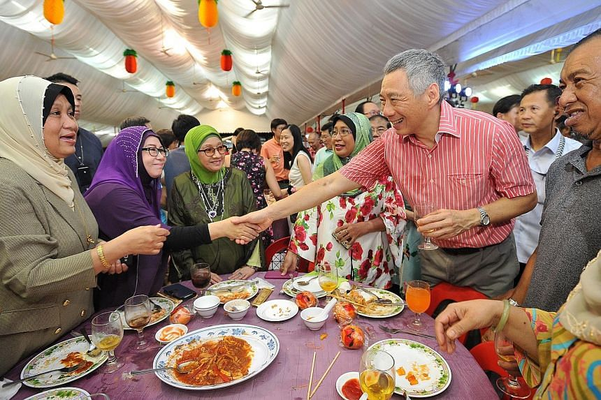 PM Lee Hsien Loong meeting actress Aznah Hamid, 57, at the table with Teck Ghee's Pioneer Generation residents during the Chinese New Year celebration dinner last night.