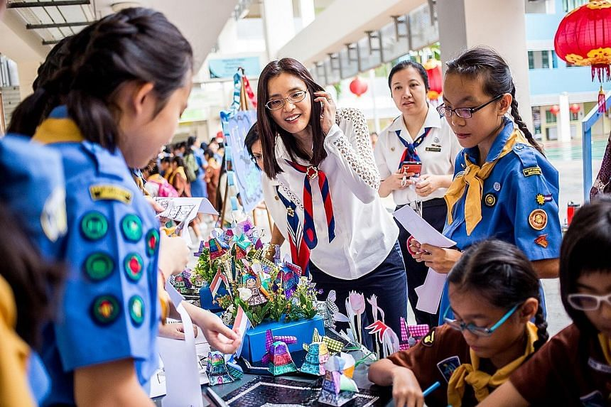 President of Girl Guides Singapore Chang Hwee Nee (centre), who was at Bedok Secondary School, and more than 5,000 members of the Girl Guides Singapore got together yesterday in their north, south, east and west divisions to mark World Thinking Day.