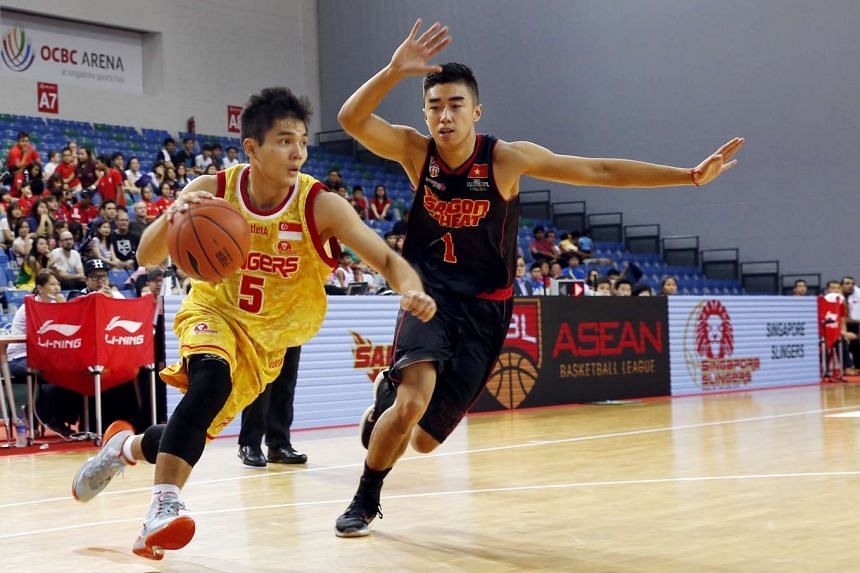 Wong Wei Long #5 of the Singapore Slingers driving against the Saigon Heat during their Asean Basketball League match on Feb 21, 2016.