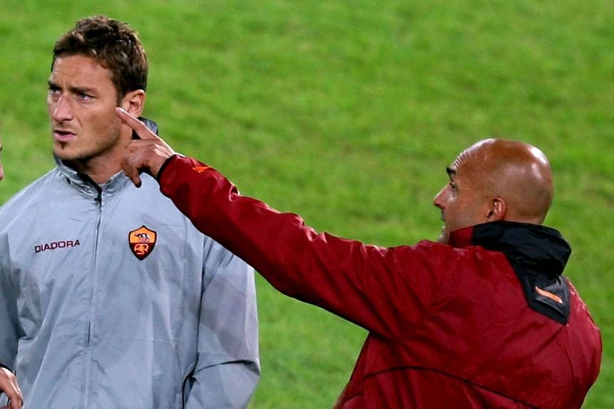 Roma's striker Francesco Totti (left) speaking with coach Luciano Spalletti during a training session on Oct 17, 2006.